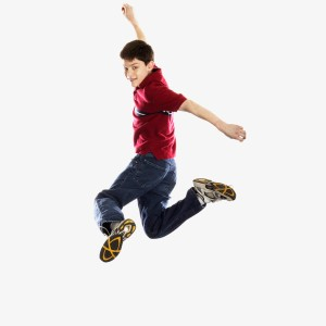Rear View of Boy Leaping into Air